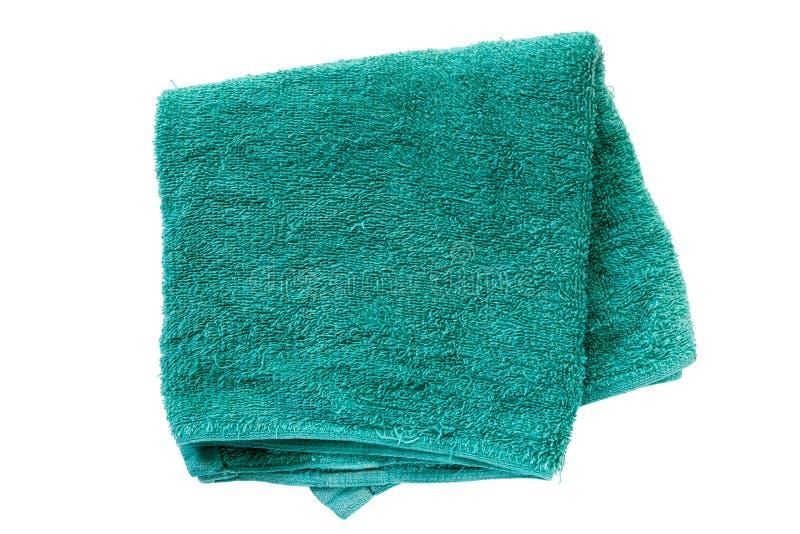 Зеленое полотенце изолированное на белой предпосылке стоковая фотография