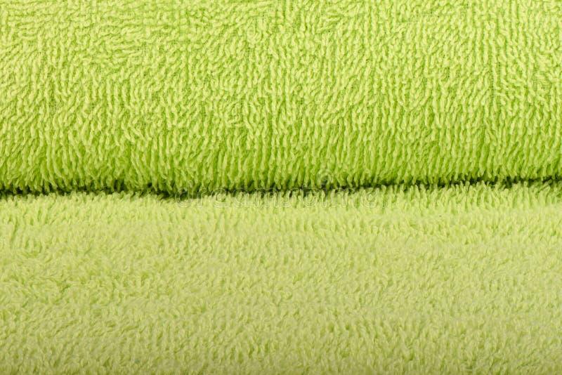Зеленое полотенце Terry Текстура полотенец ткани стоковая фотография rf