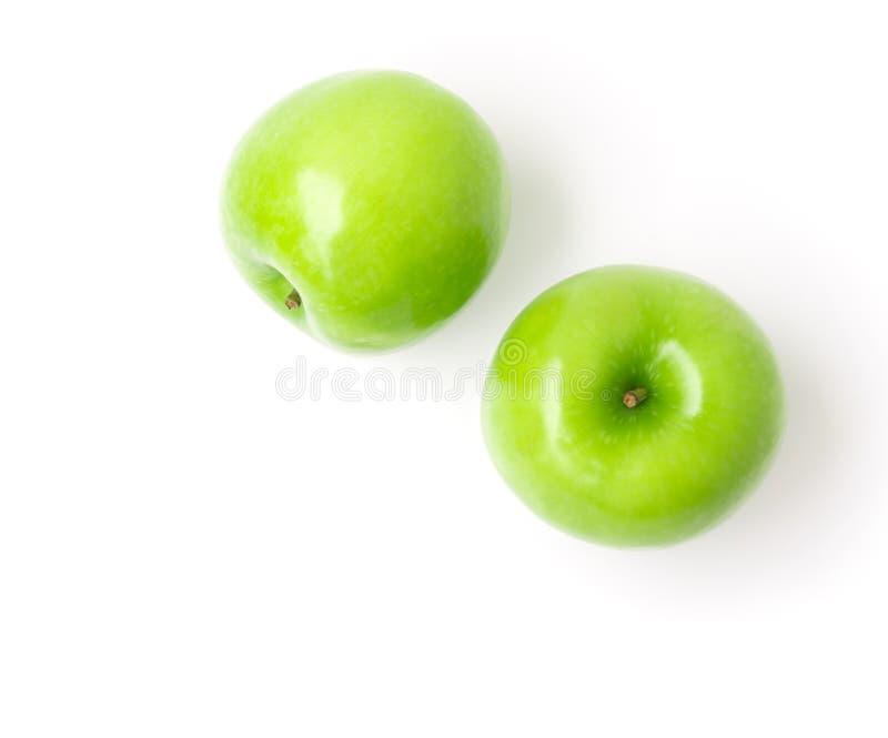 Зеленое яблоко на белой предпосылке, приносить здоровая концепция, взгляд сверху стоковое фото rf