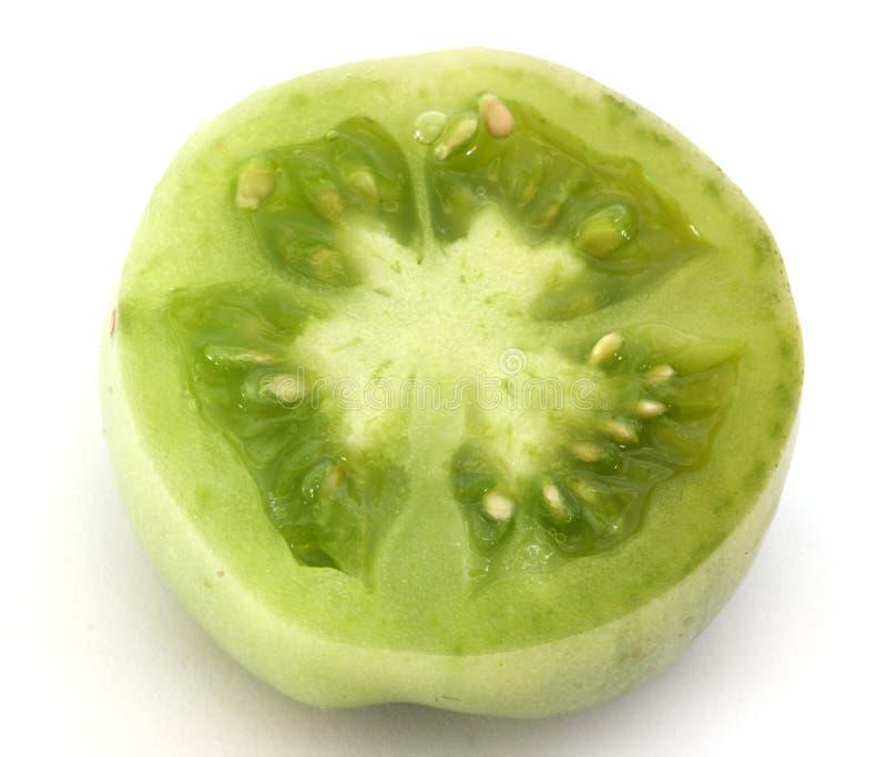 зеленое tomatoe ломтика стоковая фотография rf