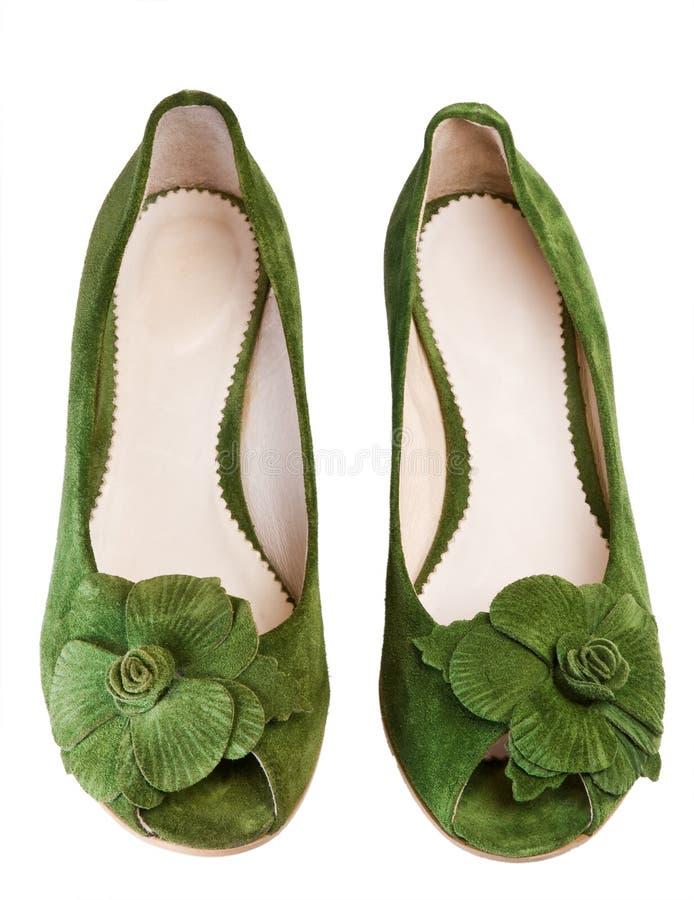 зеленые ботинки стоковые изображения