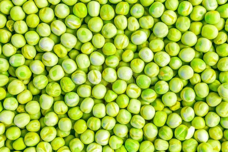 Зеленые горохи как предпосылка стоковые фото