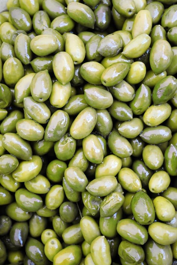 Зеленые оливки стоковые изображения