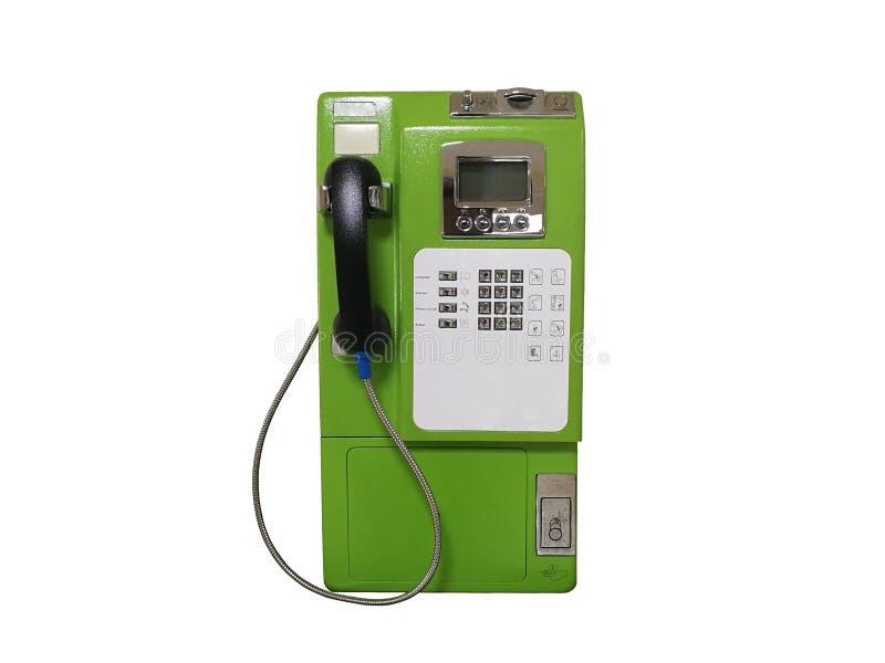 Зеленый общественный телефон изолированный на белой предпосылке стоковые фотографии rf