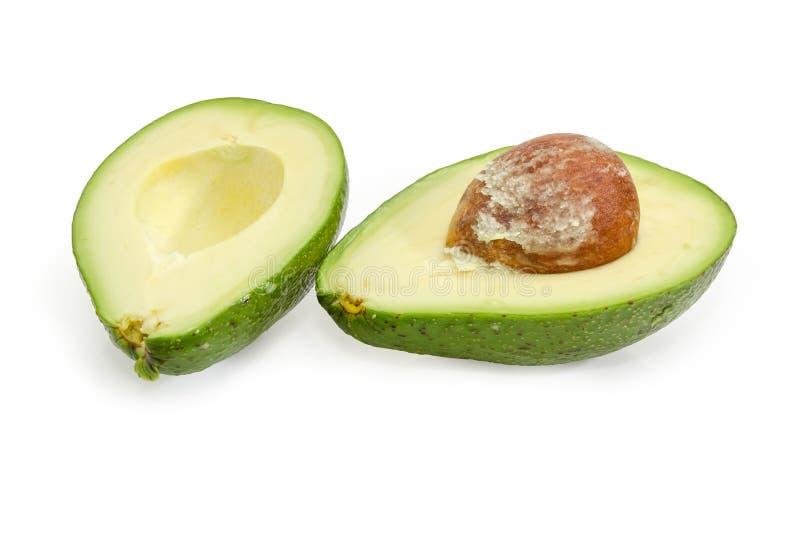 Зеленый отрезок плода авокадоа в половине на белой предпосылке стоковое изображение