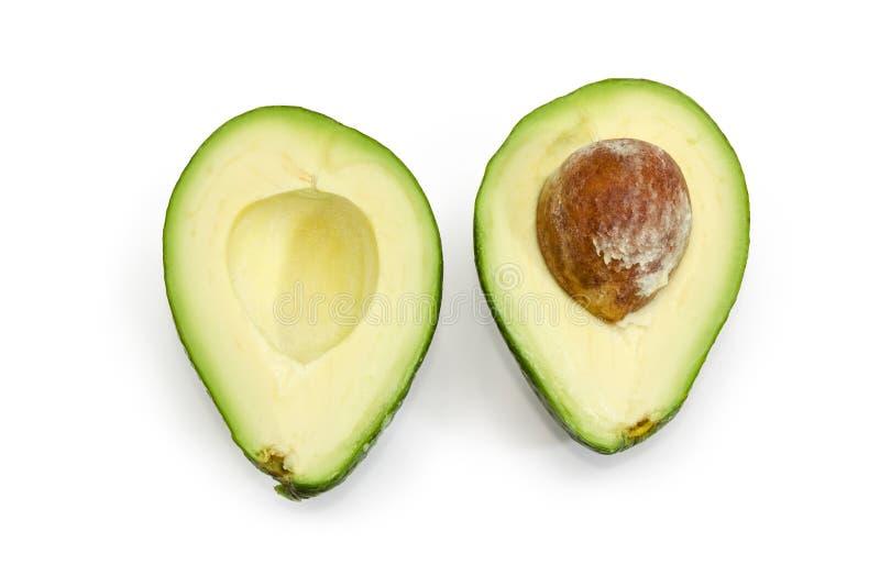 Зеленый отрезок плода авокадоа в половине на белой предпосылке стоковые изображения rf