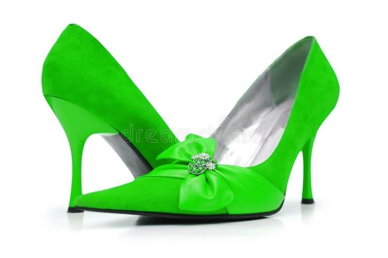 зеленый цвет обувает женщину стоковое фото rf