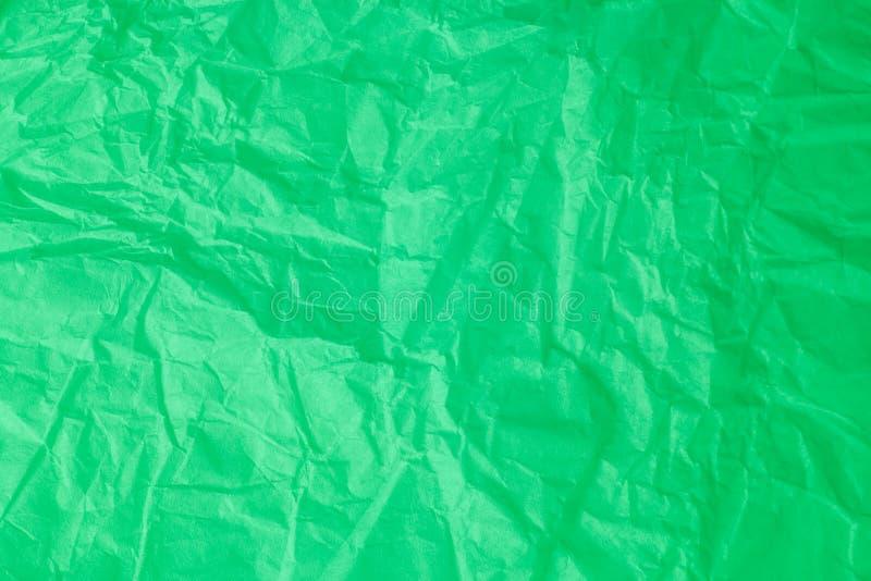 Зеленый цвет скомкал бумажную предпосылку стоковое фото rf