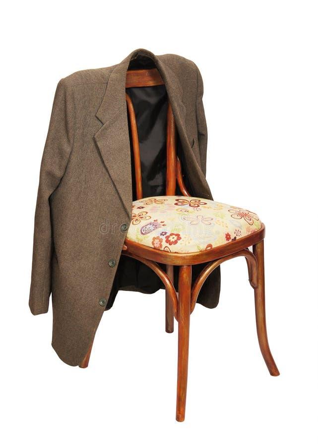 зеленый цвет стула висит куртку стоковое фото