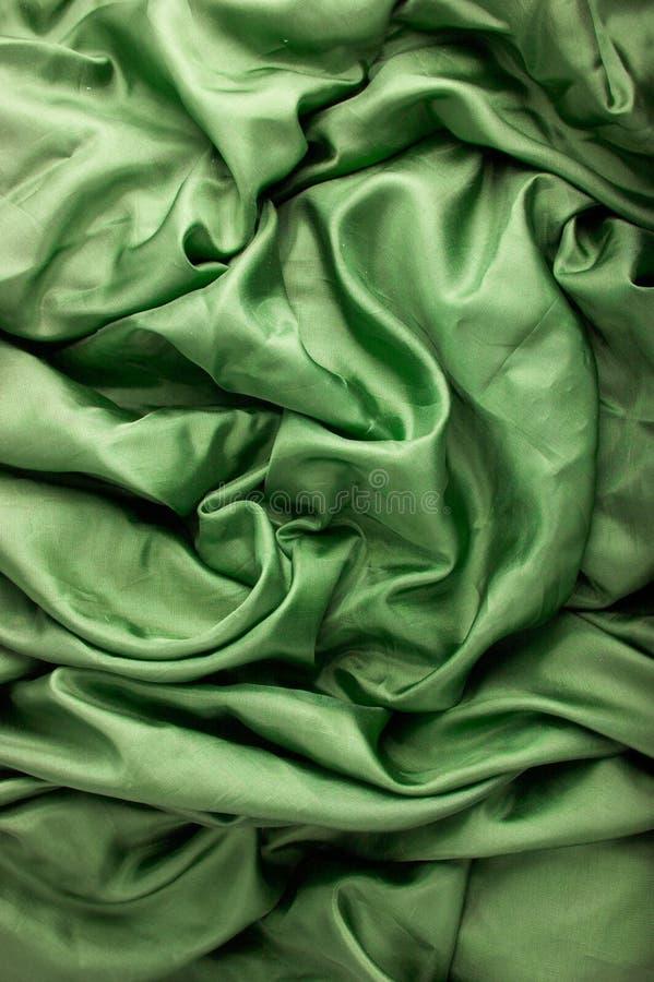 зеленый цвет ткани предпосылки стоковые изображения