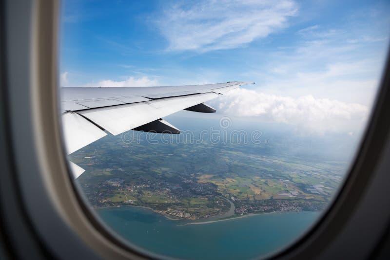 Земля, океан от плоского окна стоковая фотография rf