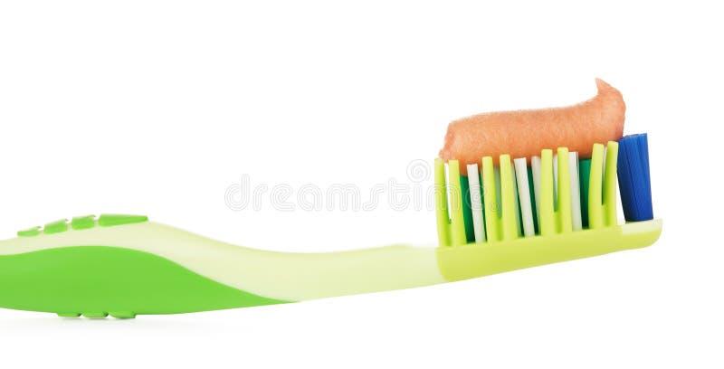 Зеленая зубная щетка с травяной зубной пастой стоковое фото rf