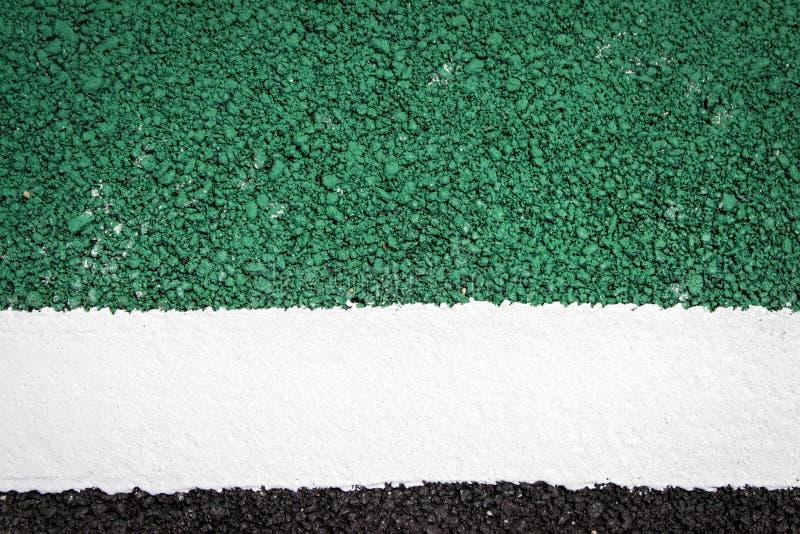 Зеленая предпосылка текстуры дорожного покрытия стоковое фото rf