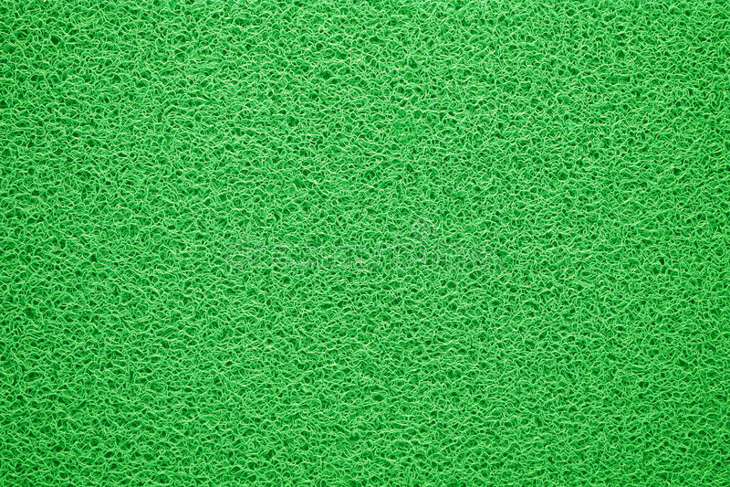 Зеленая предпосылка текстуры половика стоковые изображения