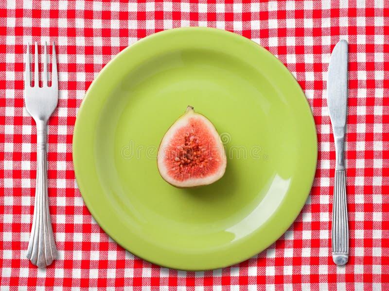 Зеленая плита обедающего с FIG. стоковая фотография