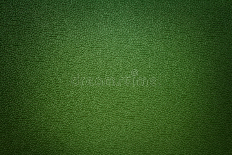 Зеленая синтетическая кожаная предпосылка с виньеткой стоковая фотография