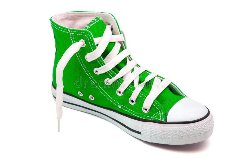 Зеленые ботинки спортов стоковое фото rf
