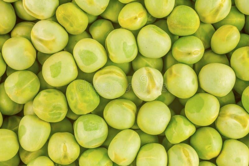 Зеленые горохи как предпосылка стоковые изображения rf