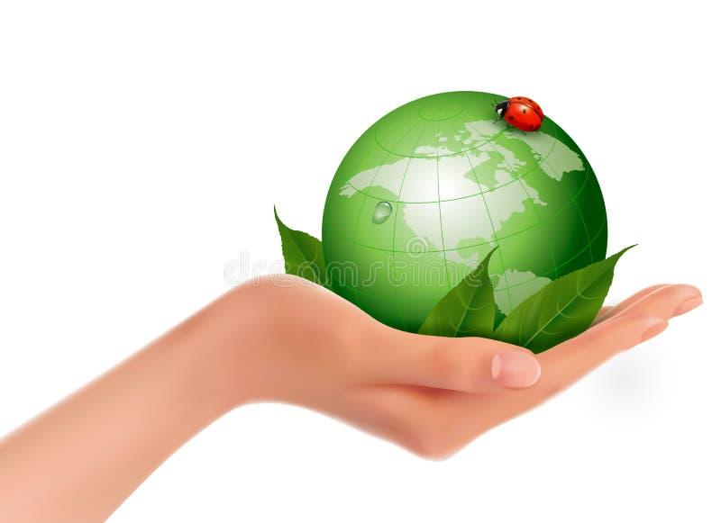 Зеленые мир и лист имеют черепашку влюбленности в руке женщины. иллюстрация штока