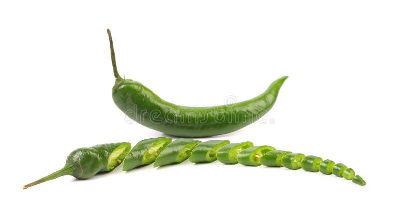 Зеленые перец и куски chili стоковые изображения