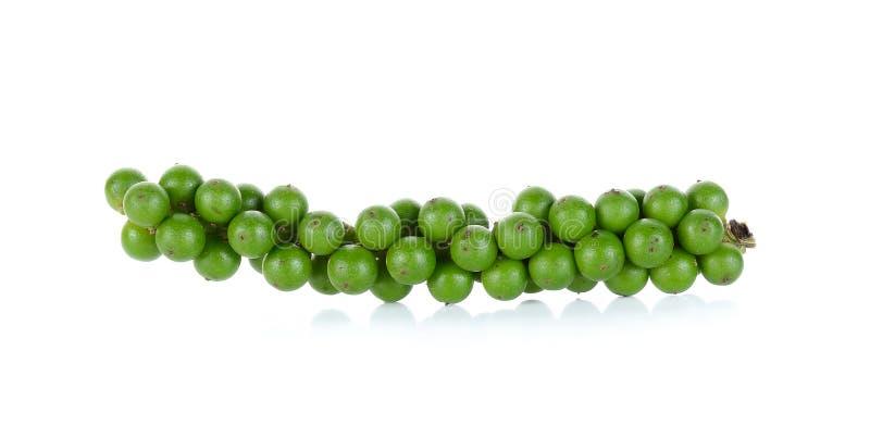 Зеленые перчинки изолированные на белой предпосылке стоковое фото rf