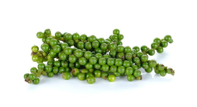 Зеленые перчинки на белой предпосылке стоковое фото