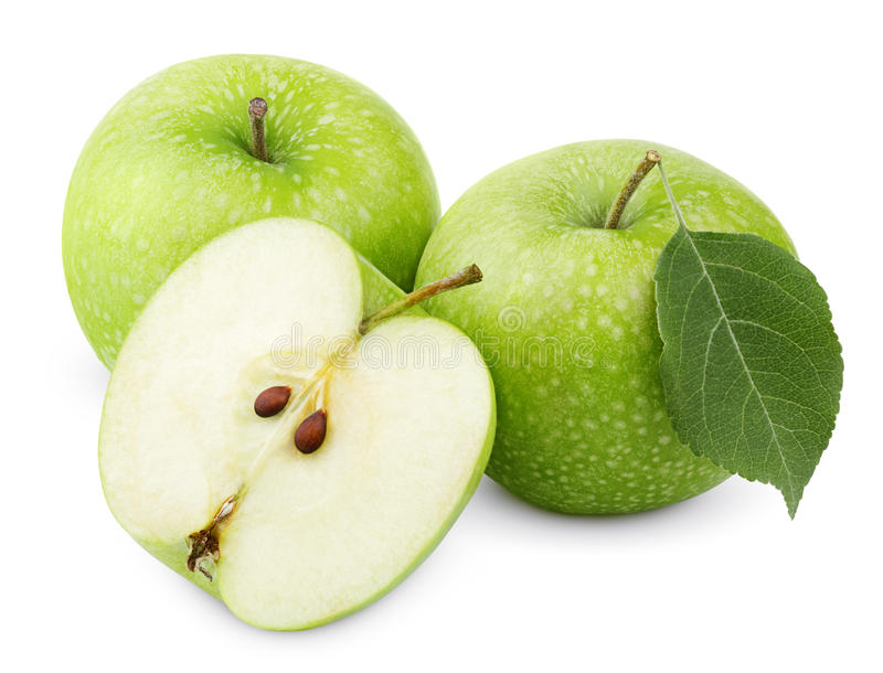 Зеленые яблоки с лист и половина изолированные на белизне стоковая фотография rf