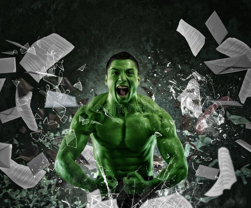 Зеленый мощный мышечный человек стоковое изображение rf