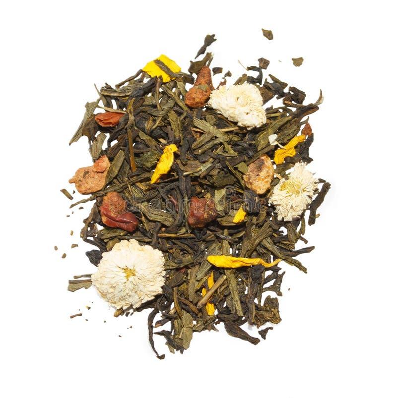 Зеленый чай с цветками и плодоовощами стоковые изображения rf