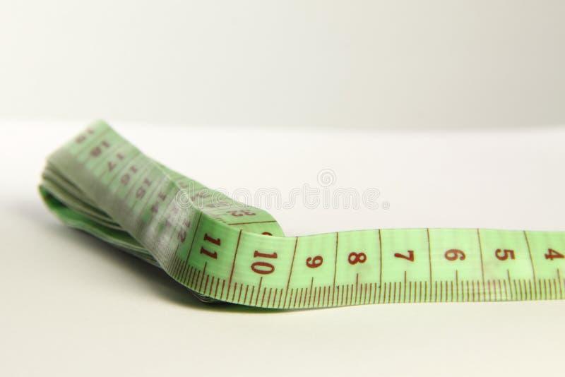 Зеленый tapemeasure стоковое фото rf