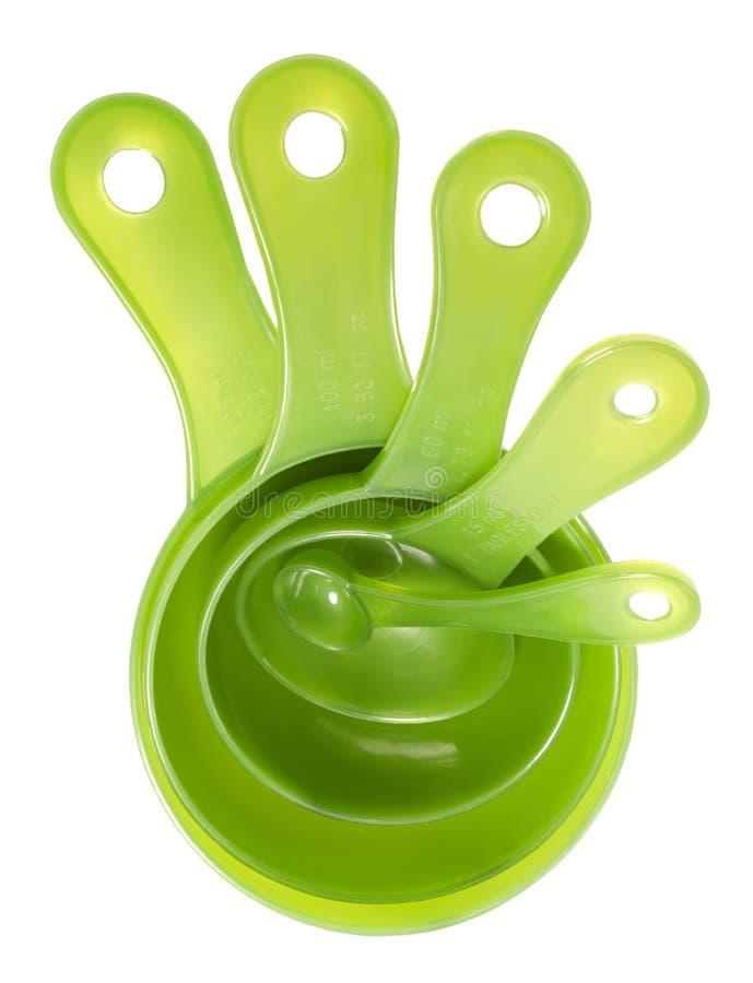 5 зеленых пластичных измеряя ложек стоковое фото rf