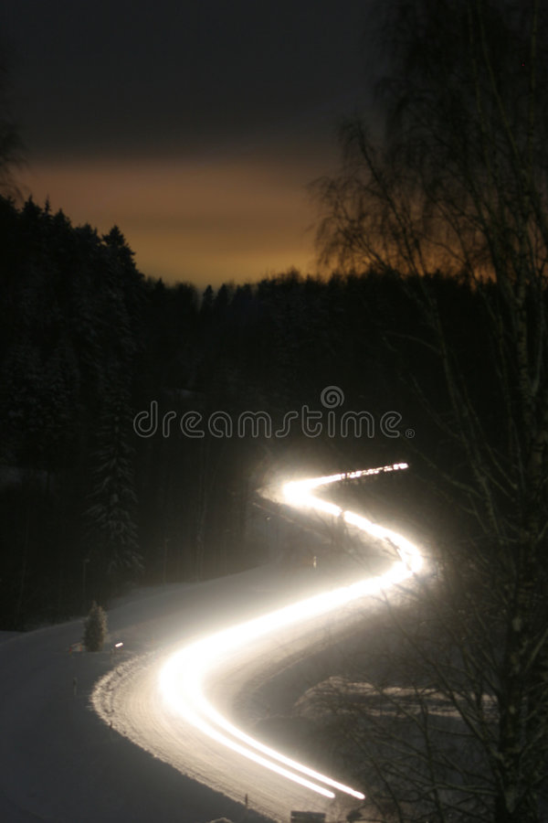 зима дороги ночи нерезкости стоковая фотография