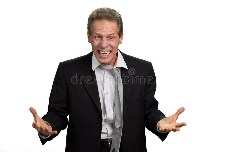 Злющий сердитый босс на белой предпосылке стоковое фото rf