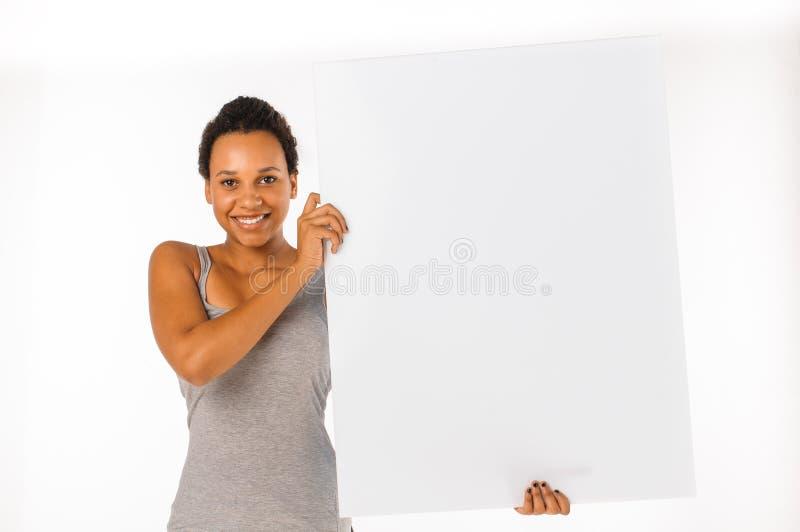 знака удерживания афроамериканца женщина пустого белая стоковое фото rf
