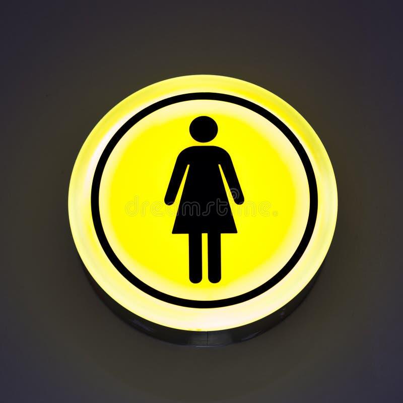 Знаки туалета женские на абстрактной предпосылке стены скопируйте космос Концепция рода женщины, феминизм стоковые изображения