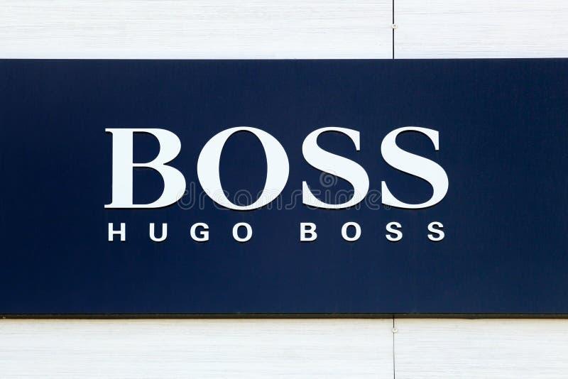 Знак босса Хьюго на магазине стоковое фото rf