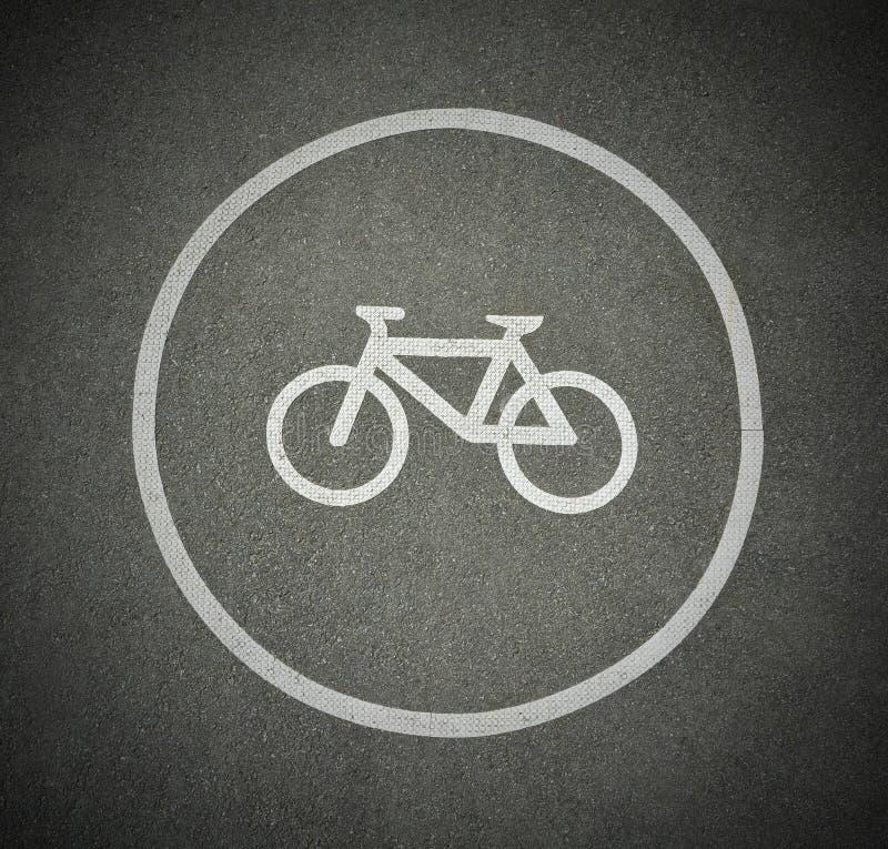 Знак велосипеда на майне велосипедиста маркировки текстуры асфальта на дороге стоковая фотография