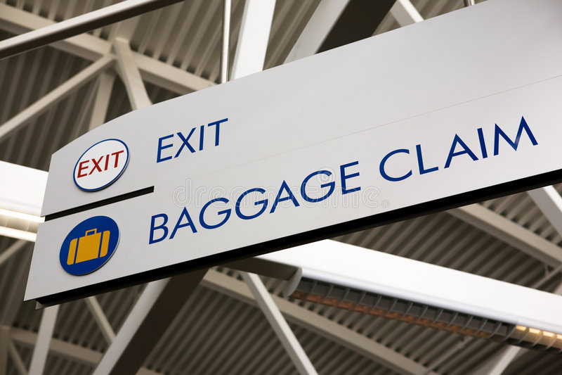 знак выхода заявки багажа стоковые фото