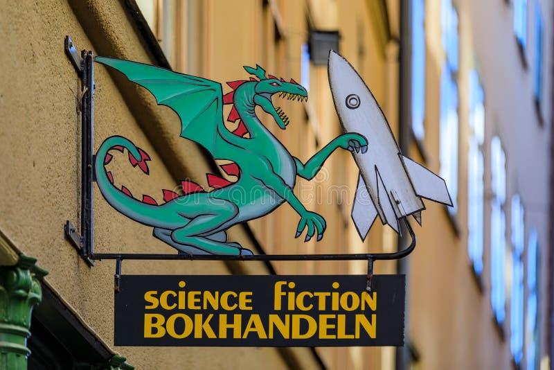 Знак книжного магазина научной фантастики металла старого стиля владения дракона стоковое изображение