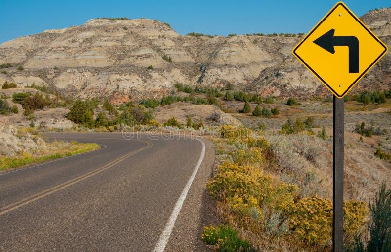 Знак левого поворота стоковая фотография