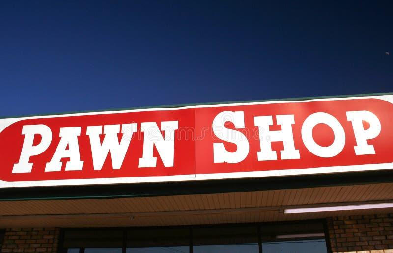 знак магазина пешки стоковые изображения