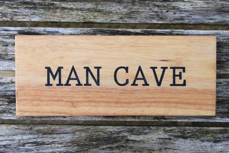 Знак пещеры человека стоковая фотография rf