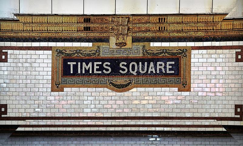 Знак подземки мозаики плитки Таймс площадь стоковые изображения