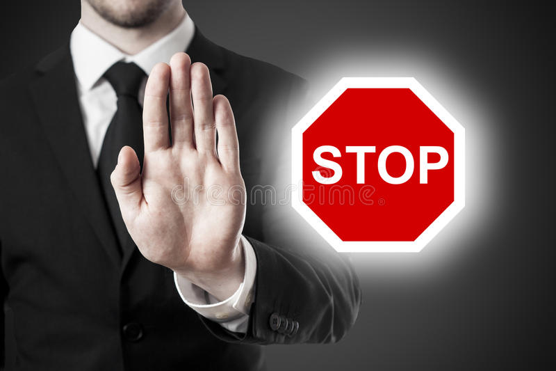 Знак стопа руки бизнесмена стоковые фото