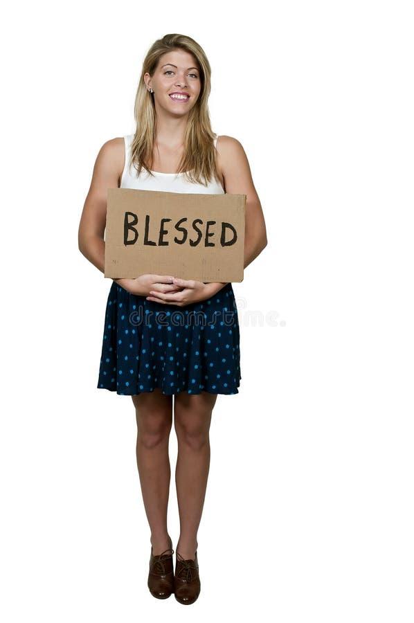Знак удерживания женщины который говорит благословлено стоковая фотография