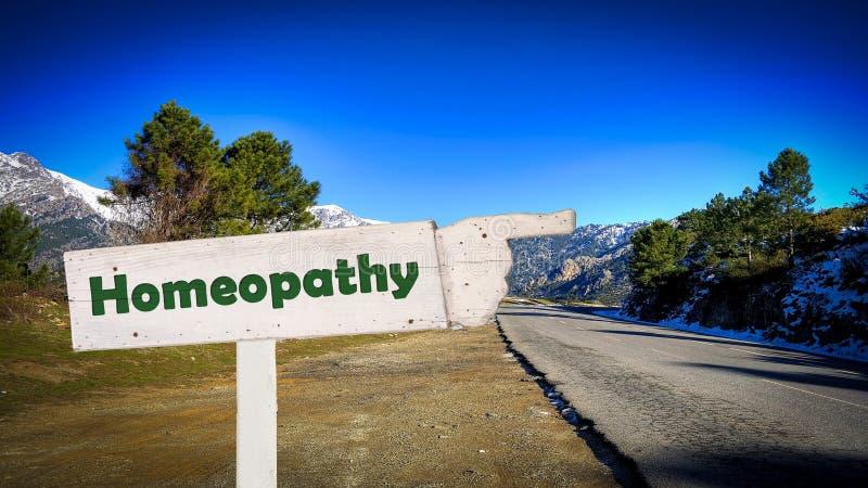 Знак улицы к гомеопатии стоковое фото rf
