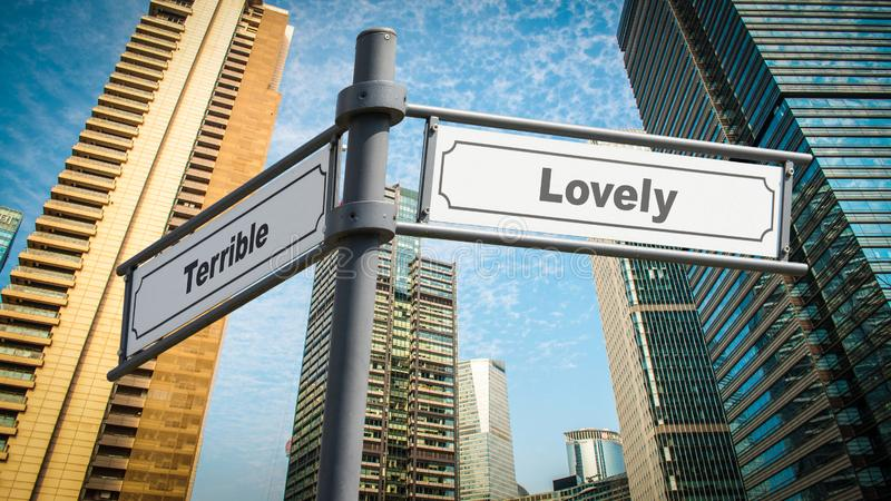Знак улицы к прекрасному против ужасного стоковое изображение rf