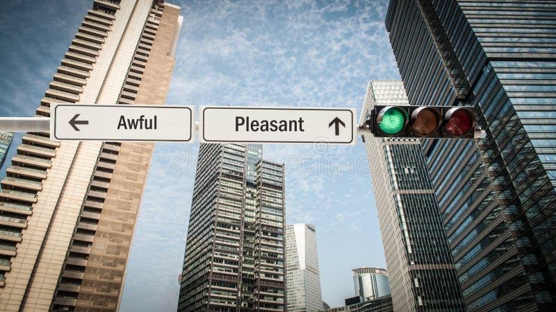Знак улицы приятный против ужасного стоковое изображение