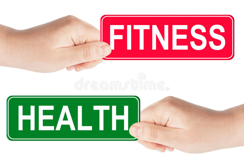 Знак уличного движения пригодности и здоровья в руке стоковое изображение