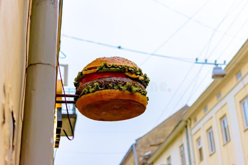 Знак улицы в форме большого Mac стоковая фотография rf